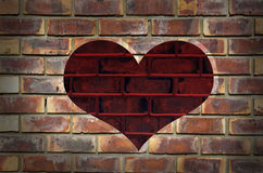 Red heart on a textured wall Stock Images