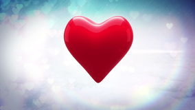 Red heart thumping on glittering background stock video footage