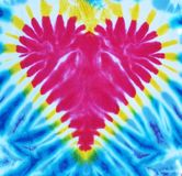 Red heart tie dyed. A background of a red tie dyed heart Royalty Free Stock Image