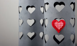 Red heart on a tin box. With heart-shaped holes, selective focus Stock Photo