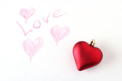 Red heart toy on a hand painted paper Stock Image