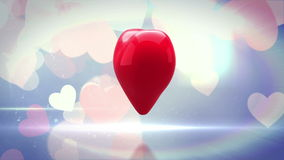 Red heart turning and exploding on glittering background stock video footage