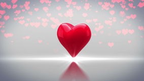 Red heart turning and exploding on grey background stock video footage