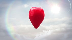 Red heart turning and exploding over blue sky stock video footage