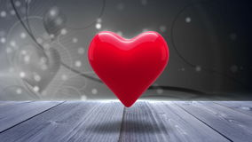 Red heart turning on glittering background stock footage
