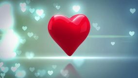 Red heart turning on glittering background stock video footage