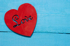 Red heart on turquoise background. Love Stock Photography