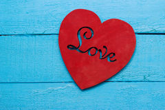 Red heart on turquoise background. Love Stock Images