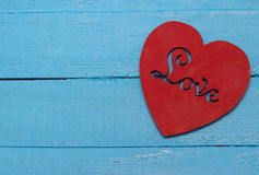 Red heart on turquoise background. Love Stock Photos