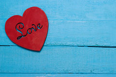 Red heart on turquoise background. Love Stock Photo
