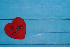 Red heart on turquoise background. Love Stock Image