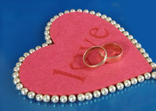 Red heart and two ring Royalty Free Stock Photo