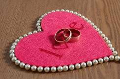 Red heart and two ring Royalty Free Stock Photography