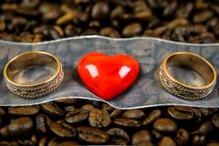 Red heart with two rings Royalty Free Stock Photos
