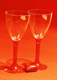 Red heart with two shiny wine glasses Royalty Free Stock Photos