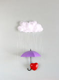 Red heart under purple umbrella Stock Photography