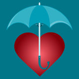 Red heart under the umbrella. Stock Image