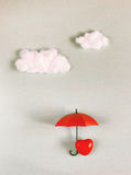 Red heart under an umbrella Stock Photos