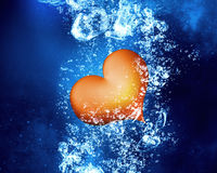 Red heart under water. Red love heart under clear blue water stock photo