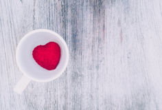 Red heart valentine coffee cup in the background the red heart Cup. Background on the plank Royalty Free Stock Photo
