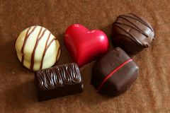 Red heart in valentines chocolates Royalty Free Stock Images