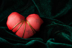 Red Heart on the Velor Background. Single  Red Heart on the Green Soft Velor Background Royalty Free Stock Image