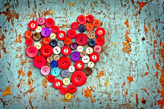 Red heart from Vintage buttons. Vintage buttons on old wooden table Royalty Free Stock Photo