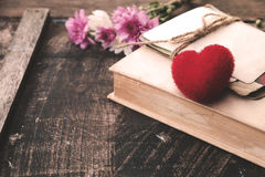 Red heart and vintage novel book Stock Photo