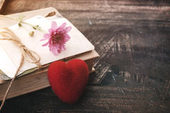 Red heart and vintage novel book - Royalty Free Stock Image