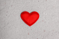 Red heart on vintage  paper background Royalty Free Stock Images