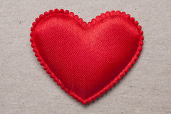 Red heart on vintage  paper background Stock Photos