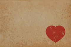 Red heart on vintage paper with copyspace Stock Photos