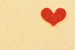 Red heart on vintage parchment paper background Stock Image