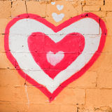 Red heart on wall. Royalty Free Stock Photo
