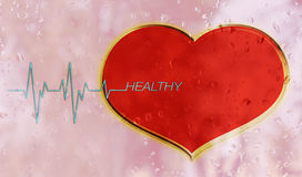 Red heart on water drop mirror with pulse or heart beat and text Royalty Free Stock Photo