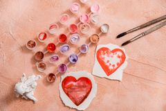Red heart, watercolor or paint, pink Valentine. On a pink coral background. Painted heart. Red heart, watercolor or paint, pink Valentine. On a pink coral royalty free stock images