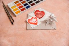 Red heart, watercolor or paint, pink Valentine. On a pink coral background. Painted heart. Red heart, watercolor or paint, pink Valentine. On a pink coral stock photo