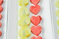 Red heart watermelon with pineapple on the dish Stock Images
