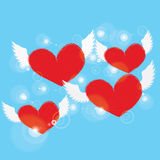 Red heart with white angel wing on blue background Royalty Free Stock Photos