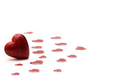 Red heart on white background. Red heart and confetti on white background Royalty Free Stock Images