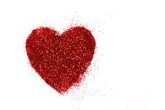 Red heart on a white background. Heart of glitter grains. glitter makeup Stock Photography