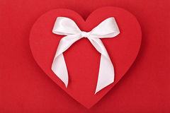 Red heart and white bow Royalty Free Stock Photography