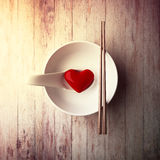 Red heart in the white bowl of health-care concept Royalty Free Stock Photo