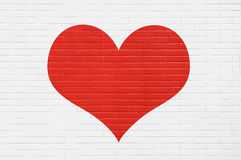 Red heart on a white brick wall. love concept Royalty Free Stock Photo