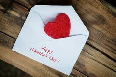 Red heart in white envelope. Valentines day. Royalty Free Stock Image