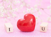 Red heart and white flowers, and wooden cubes Stock Photography