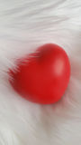 Red heart on white fur background. Red heart on a white faux fur background Royalty Free Stock Images