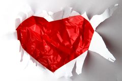 Red heart in the white paper Stock Photography
