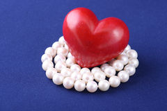 Red heart and white pearls Royalty Free Stock Images