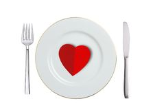 Red heart on white plate, spoon and fork isolated on white Royalty Free Stock Images